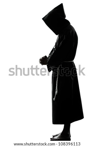 one caucasian man priest praying silhouette in studio isolated on white background - stock photo