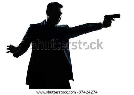 one caucasian man with gun aiming portrait silhouette in studio isolated white background - stock photo
