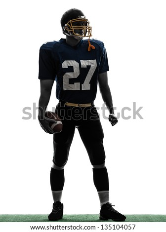 one caucasian quarterback american football player man standing in silhouette studio isolated on white background - stock photo