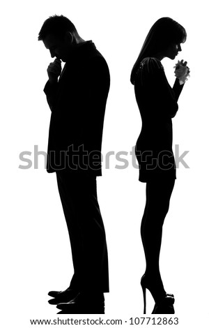 one caucasian sad couple back to back man thinking and woman crying standing back to back man and woman in studio silhouette isolated on white background - stock photo