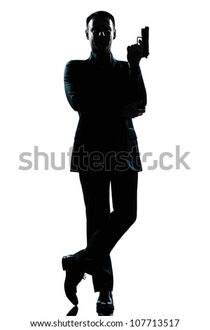 one caucasian secret agent in a james bond posture holding gun full length silhouette in studio isolated white background - stock photo