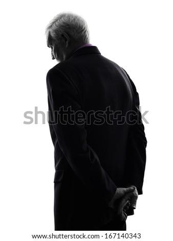 One Caucasian senior business man sad rear view silhouette White Background - stock photo