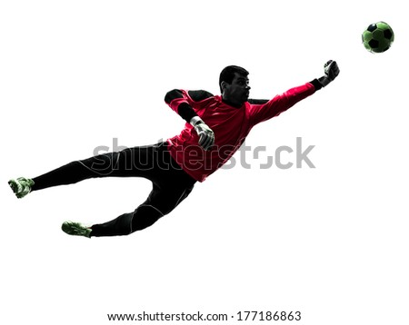 one caucasian soccer player goalkeeper man punching ball in silhouette isolated white background - stock photo