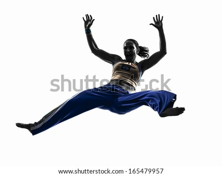 one caucasian woman capoeira dancer dancing in silhouette studio isolated on white background - stock photo