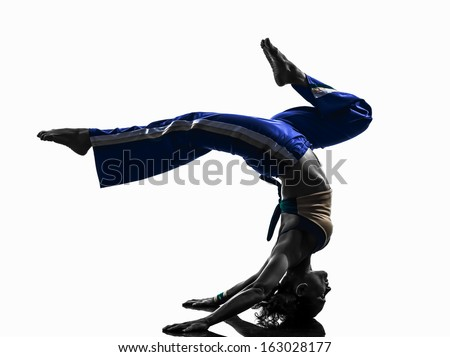 one caucasian woman capoiera dancer dancing in silhouette studio isolated on white background - stock photo