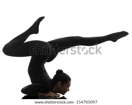 one caucasian woman contortionist practicing gymnastic yoga  in silhouette   on white background - stock photo