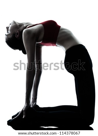 one caucasian woman exercising yoga camel pose in silhouette studio isolated on white background - stock photo
