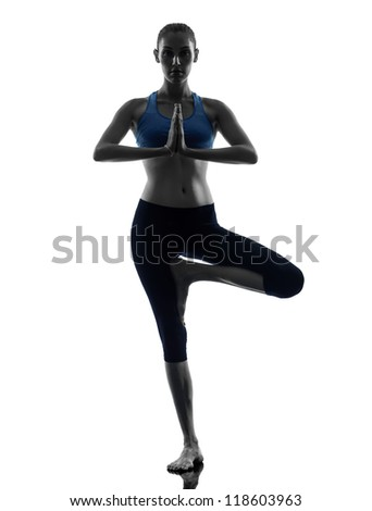 one caucasian woman exercising yoga tree pose in silhouette studio isolated on white background - stock photo