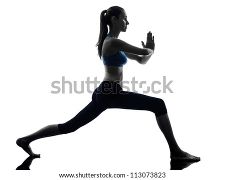 one caucasian woman exercising yoga warrior position in silhouette studio isolated on white background - stock photo