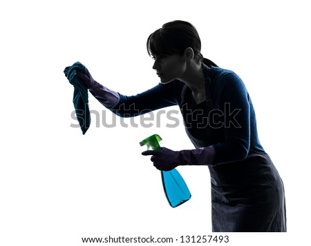 one caucasian woman maid cleaning  in silhouette studio isolated on white background - stock photo