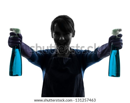 one caucasian woman maid window cleaning sprayer   in silhouette studio isolated on white background - stock photo