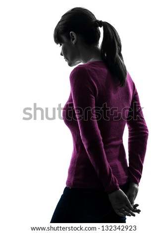 one caucasian woman sad moody rear view in silhouette studio isolated on white background - stock photo