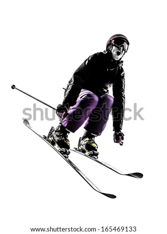one caucasian woman skier skiing jumping in silhouette on white background - stock photo