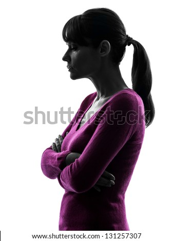 one caucasian woman thinking sadness in silhouette studio isolated on white background - stock photo