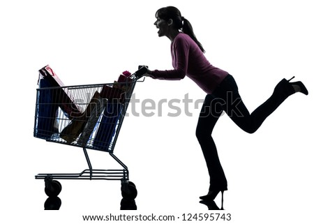 one caucasian woman with full shopping cart in silhouette studio isolated on white background - stock photo