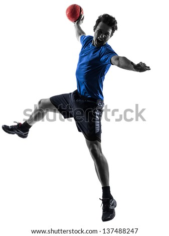 one caucasian young man exercising handball player in silhouette studio isolated on white background - stock photo