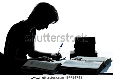 one caucasian young teenager silhouette boy or girl studying reading books in studio cut out isolated on white background - stock photo