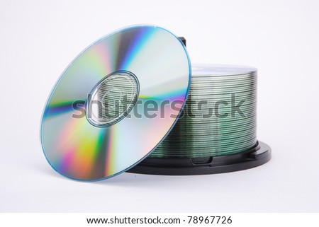 one cd and disks pile on white - stock photo
