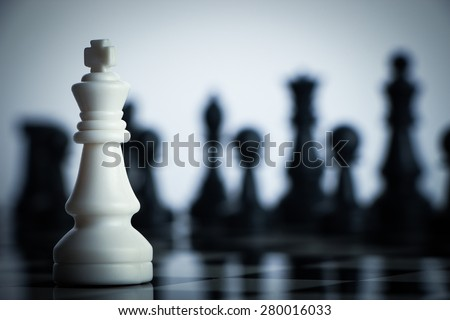 One chess is staying against full army of chess pieces. - stock photo