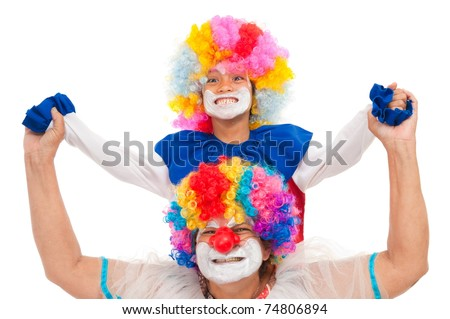 One child with an adult clown smiling - stock photo