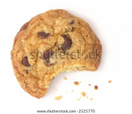 One chocolate chip cookie with a bite taken out and crumbs scattered around, isolated on white background. - stock photo