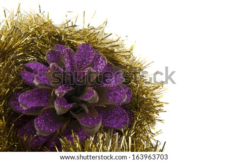 one christmas pinecone painted with magenta glitter and christmas decoration - stock photo
