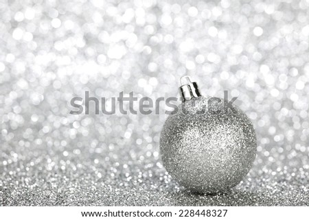 One chritmas ball on glitters with bokeh background - stock photo