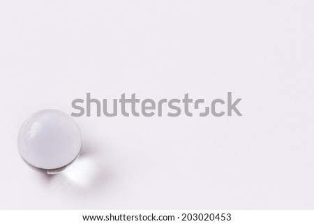 One clear glass marble - Lower left - stock photo