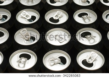 one closed and some opened black canned beer - stock photo