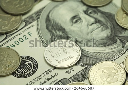 one coin in the Russian ruble against the background of one hundred dollars abstract background - stock photo