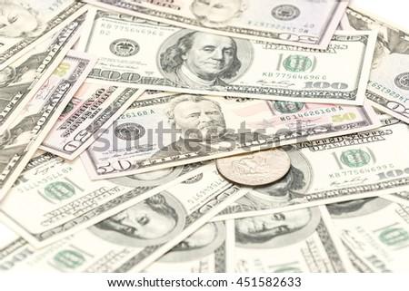 One collection silver dollar with hundreds and fifty banknotes as background - stock photo