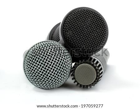one condenser microphone and two dynamic microphones, isolated on white background - stock photo