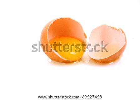 One cracked hen's egg isolated on white - stock photo