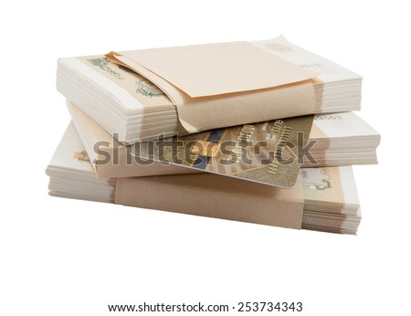 one credit card and can replace several stacks of money - stock photo