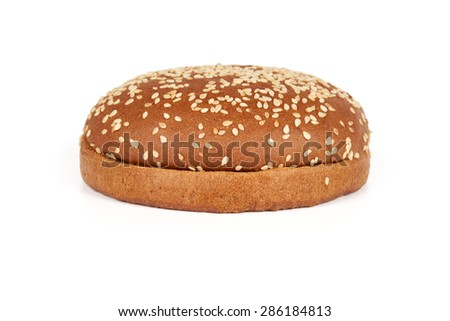 One dark hamburger bun with sesame seeds sliced in two halves isolated on white background - stock photo