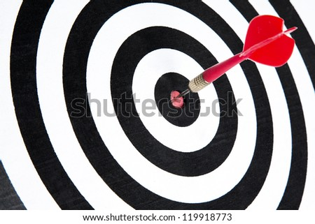 One dart is hitting perfectly on the black dart board with good accuracy - stock photo