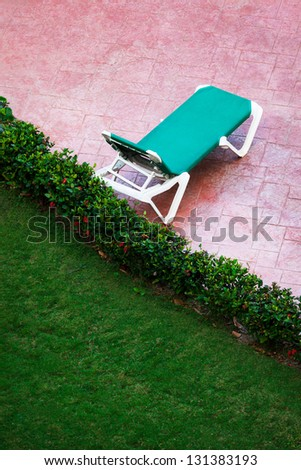 one deck chair on a cloudy day - stock photo