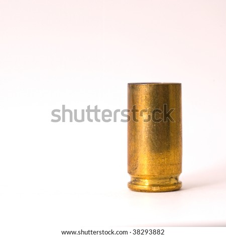 One Dirty 9 mm shell casing primer down - stock photo