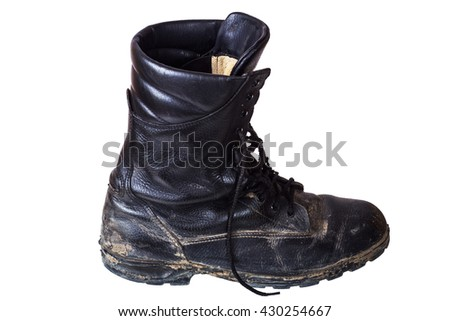 One dirty old boot on his right foot. Army boots. Isolated on white background. - stock photo