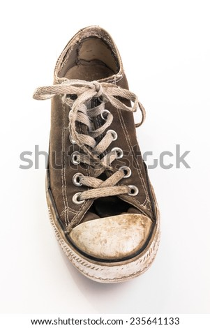 One dirty old sneaker seen from above, on white background - stock photo