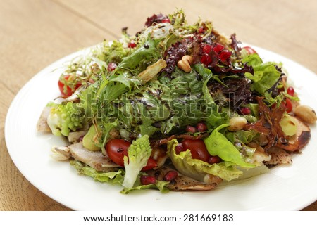 one dish of salad on wood table - stock photo