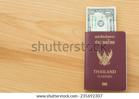 one dollar bill thai passport - stock photo