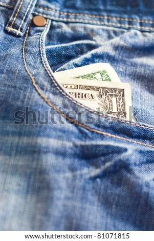 one dollar in jeans pocket with shallow depth of field - stock photo