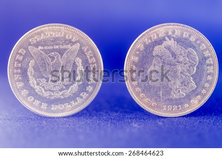 One dollar silver coin front and reverse - stock photo