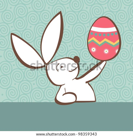 One Easter bunny with painted Easter egg in the hand on pastel green background. - stock photo