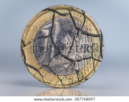 One euro coin cracked as metaphor of euro currency collapse - stock photo