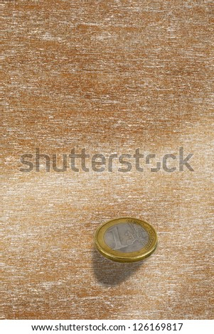 One euro coin falls to the floor - stock photo