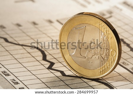 one euro on newspaper chart - stock photo