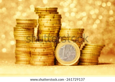 One euro over coins stacks on abstract background - stock photo