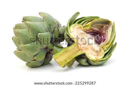 One fresh artichokes with stem and leaf and a half showing the heart. Isolated.  - stock photo